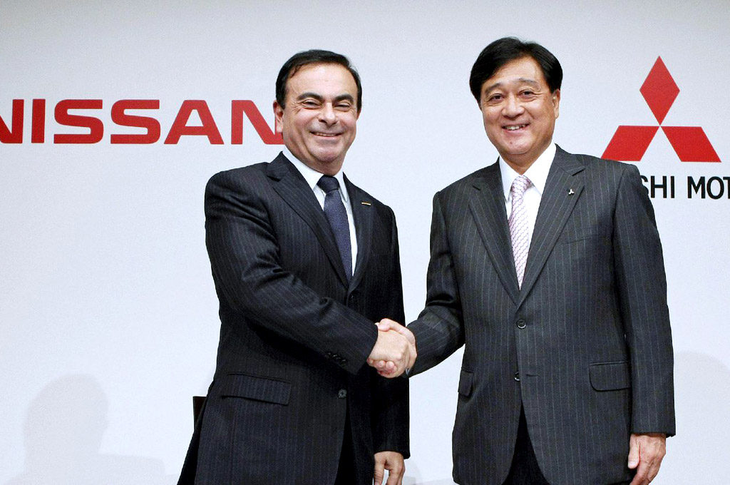 Carlos Ghosn y Osamu Masuko